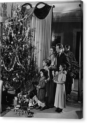 Family With Three Children (4-9) Standing At Christmas Tree, (b&w) Canvas Print by George Marks