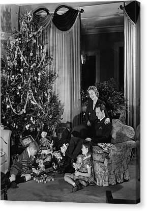 Family With Two Children (6-9) Sitting At Christmas Tree, (b&w) Canvas Print by George Marks