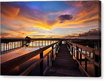 Fantastic Sky On Wood Bridge Canvas Print by Arthit Somsakul