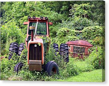 Farm Equipment Canvas Print by Susan Leggett