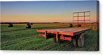 Farm Trailer With Bales At Sunset Canvas Print by Vbainesphotography