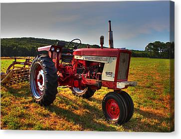 Farmall Tractor In The Sunlight Canvas Print by Andrew Pacheco