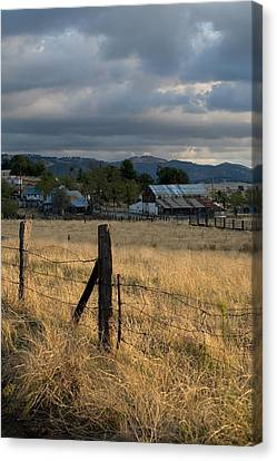 Farmland Fence Post Canvas Print by Peter Tellone