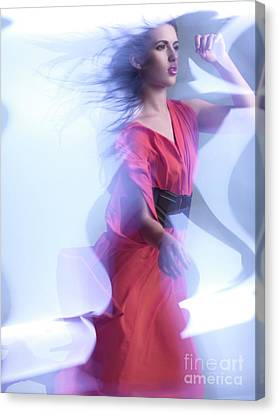 Fashion Photo Of A Woman In Shining Blue Settings Wearing A Red  Canvas Print by Oleksiy Maksymenko