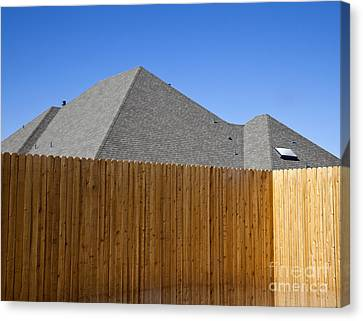 Fence And Roof Canvas Print by David Buffington