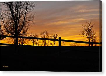 Fence At Sunset Canvas Print by Edward Peterson