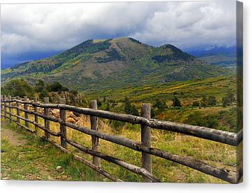 Fence Row And Mountains Canvas Print by Marty Koch