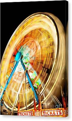 Ferris Wheel At Night Canvas Print by Paul Velgos