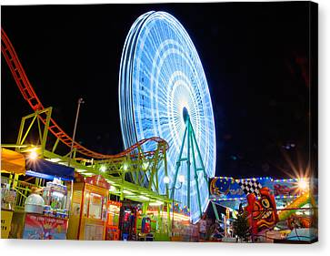 Ferris Wheel At Night Canvas Print by Stelios Kleanthous