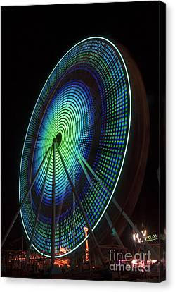 Ferris Wheel Lit Shades Of Green And Blue Canvas Print by Darleen Stry