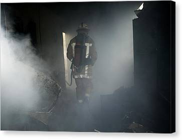 Fire Fighter In A Burnt House Canvas Print by Michael Donne