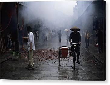 Firecrackers Litter Street Canvas Print by Raymond Gehman