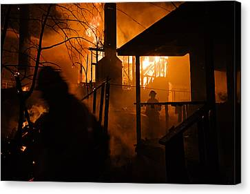Firefighters Spray Down A Burning House Canvas Print by Mark Thiessen