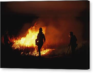 Firefighters Start A Controlled Fire Canvas Print by Joel Sartore