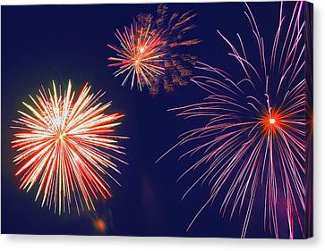 Flickering Light Canvas Print - Fireworks In The Night Sky by Carson Ganci