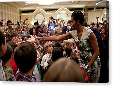 First Lady Michelle Obama Greets Canvas Print by Everett