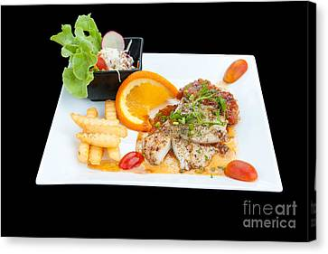 Fish Steak Canvas Print by Atiketta Sangasaeng
