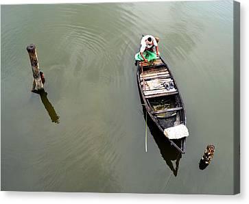 Fisherman And His Boat Canvas Print by Pallab Seth