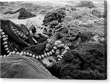 Canvas Print featuring the photograph Fisherman Sleeping On A Huge Array Of Nets by Tom Wurl
