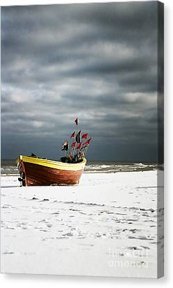 Canvas Print featuring the photograph Fishermen's Boat On Snowy Beach by Agnieszka Kubica
