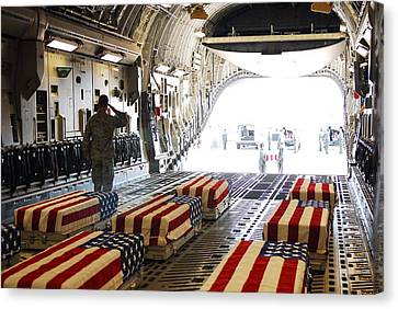 Flag Draped Coffins Of Five Us Soldiers Canvas Print by Everett