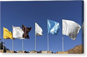 Flags Fluttering Against Blue Sky Canvas Print by Kantilal Patel