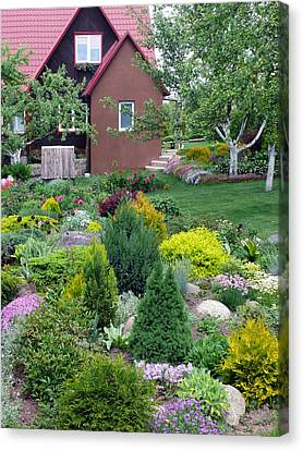 Canvas Print featuring the photograph Flowers Near The Rural House by Aleksandr Volkov