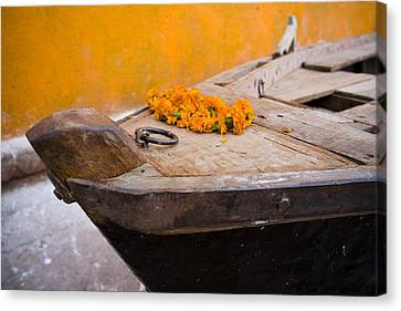 Flowers On Top Of Wooden Canoe Canvas Print by David DuChemin