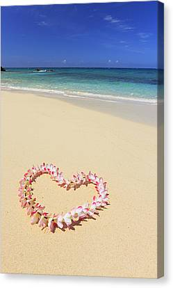 Flowers Placed In The Shape Of A Heart On Beach Canvas Print by Imagewerks