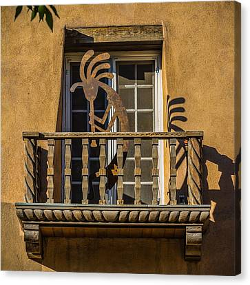 Canvas Print featuring the photograph Flute Priest At Play by Ken Stanback