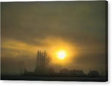 Foggy Sunrise Canvas Print by Charlie Duncan