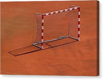 Football Net On Red Ground Canvas Print by Daniel Kulinski