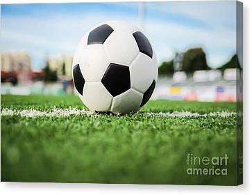 Football On Green Grass   Canvas Print by Mongkol Chakritthakool