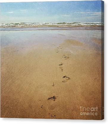 Footprints In The Sand Canvas Print by Lyn Randle