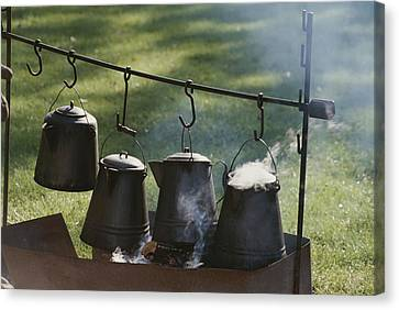 Four Metal Coffee Pots Steaming Over An Canvas Print
