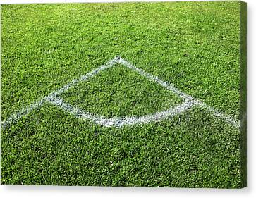 Freshly Painted Corner Area On Grass Canvas Print by Richard Newstead
