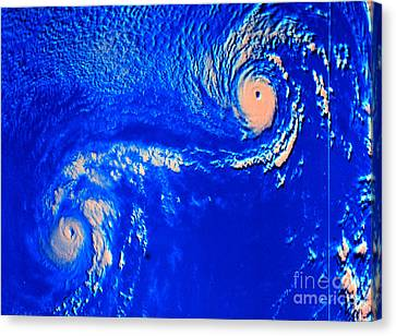 Fujiwhara Effect, Typhoons Ione Canvas Print by Science Source