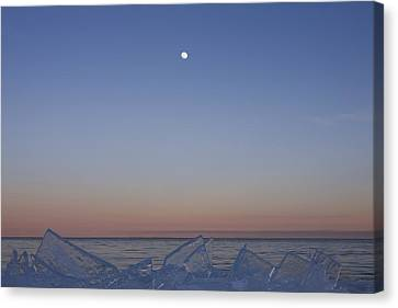 Full Moon At Dusk With Ice On Lake Canvas Print by Susan Dykstra