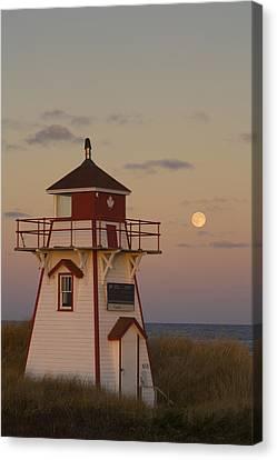 Full Moon Over Covehead Lighthouse Canvas Print by John Sylvester