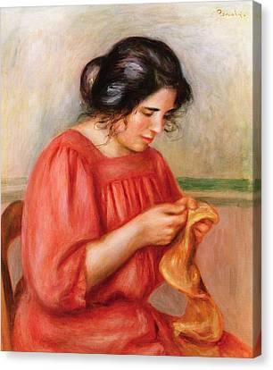 Gabrielle Darning Canvas Print by Pierre Auguste Renoir