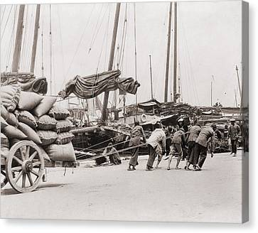 Gang Of Five Chinese Dock Workers Lean Canvas Print by Everett