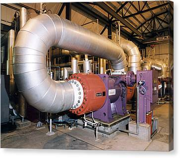 Gas Compressor At An Oil Refinery Canvas Print by Paul Rapson