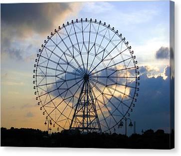 Giant Ferris Wheel At Sunset Canvas Print by Paul Van Scott