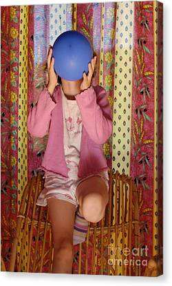 Girl Blowing Up Balloon Canvas Print by Sami Sarkis