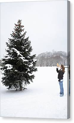 Girl Measuring Tree Height Canvas Print by Ted Kinsman