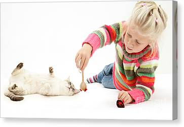Girl Playing With Cat Canvas Print by Mark Taylor