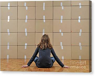 Girl Seated In Front Of Cardboard Boxes Canvas Print