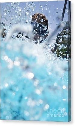 Girl Splashing Water In Swimming Pool Canvas Print by Sami Sarkis
