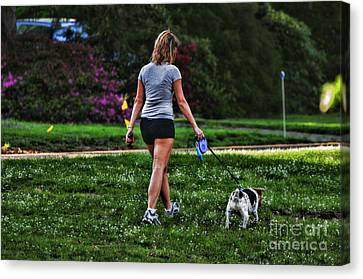 Girl Walking Dog Canvas Print by Paul Ward