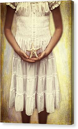 Girl With Starfish Canvas Print by Joana Kruse
